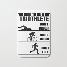 How to be a triathlete funny Bath Mat
