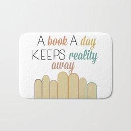 A book a day keeps reality away Bath Mat