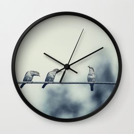 Three birds on wire, one of the bird has a food Wall Clock