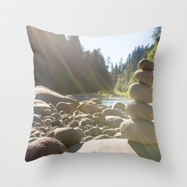 Cairn of stacked rocks along banks of Oregon river Throw Pillow