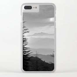 Rainbow clouds at the mountains at sunrise. BW Clear iPhone Case