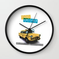 taxi driver Wall Clocks featuring Taxi driver by Marta Colomer
