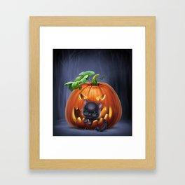 black kitten in a pumpkin Framed Art Print