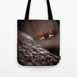 Ladybird in flight Tote Bag