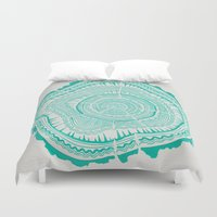 tree rings Duvet Covers featuring Turquoise Tree Rings by Cat Coquillette
