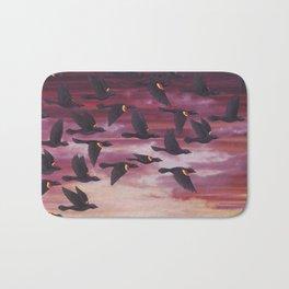 red-winged blackbird flock in flight Bath Mat