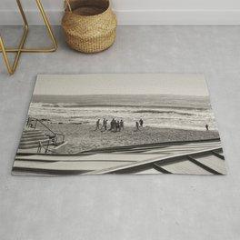 Sur la plage en groupe Rug