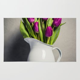 Levitating purple tulips against old concrete background Rug