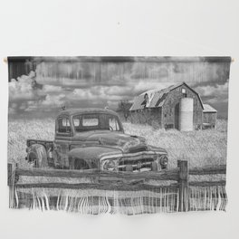 Black and White of Rusted International Harvester Pickup Truck behind wooden fence with Red Barn in Wall Hanging