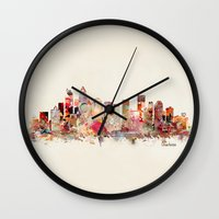 north carolina Wall Clocks featuring charlotte north carolina skyline by bri.buckley