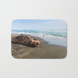 Beautiful sea, the black sandy beach and big old log, Tyrrhenian sea near Roma, Italy Bath Mat
