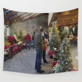 Festive flower show with model trains and buildings Wall Tapestry
