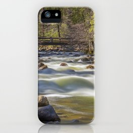 A bridge over the Merced River stands solidly over the velvety exposure of the water iPhone Case