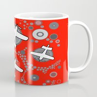 airplanes Mugs featuring airplanes in red by Isabella Asratyan