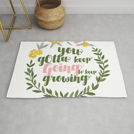 You gotta keep going to keep growing quote in floral wreath watercolor Rug