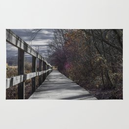 Extended wooden foot bridge through the forest Rug