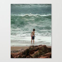 small boy against the sea Canvas Print