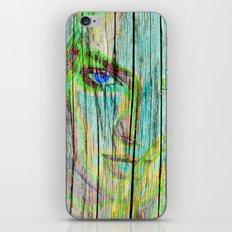 Woman on wood iPhone & iPod Skin