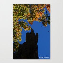 hawk statue with foliage Canvas Print