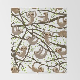 funny and cute smiling Three-toed sloth on green branch tree creeper Throw Blanket