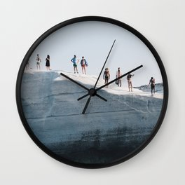 Tiny people on rocky cliff in Sarakiniko, Milos Greece Wall Clock