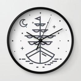 Boat illuminated by the moon and stars Wall Clock