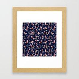 Dachshund in the snow on blue Framed Art Print