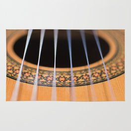 Strings of the guitar above the rose window Rug