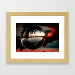 Holding a Sunrise refraction photography with a crystal ball Framed Art Print
