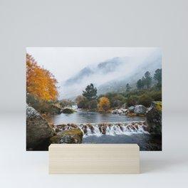 River in foggy valley Mini Art Print