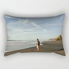 boy on black sand beach in new zealand Rectangular Pillow