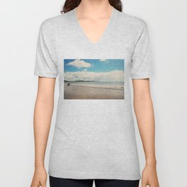 A row boat abandoned on the beach at Lyme Regis, England Unisex V-Neck