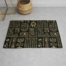 Egyptian hieroglyphs and deities gold on black Rug