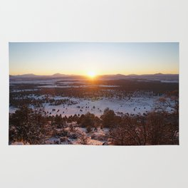 sunset at snow mountain Rug
