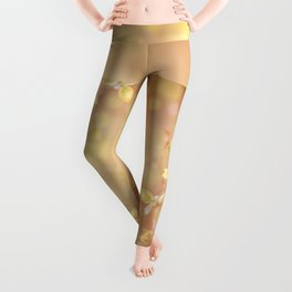 Many young spring leaves on blurred background Leggings