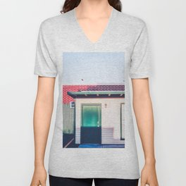 green wood building with brick building in the city Unisex V-Neck