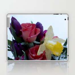 Vibrant bouquet of flowers in the snow Laptop & iPad Skin