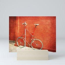 Red Tall Bike Against Brick Wall Mini Art Print
