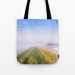 Typical Dutch landscape in Zeeland on a foggy morning Tote Bag