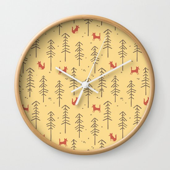 Fox hiding in the forest Wall Clock