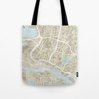 oakland Tote Bags featuring Oakland California Watercolor Map by Anne E. McGraw