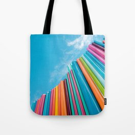 Colorful Rainbow Pipes Against Blue Sky Tote Bag