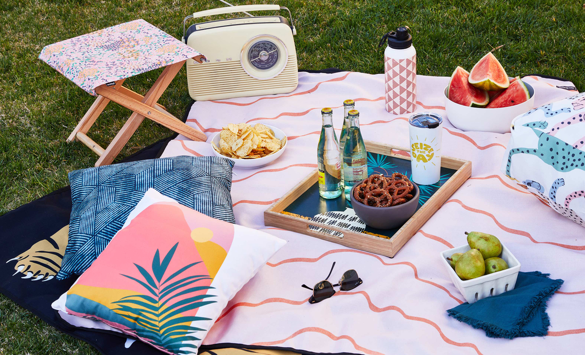 outdoor blankets with trays of snacks