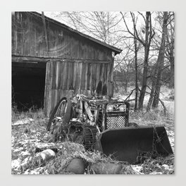Abandoned barn and tractor Canvas Print