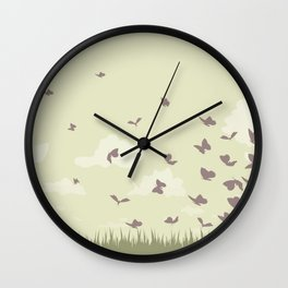 flying butterflies on a green landscape with sun Wall Clock