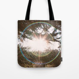 Flare light in the forest Tote Bag