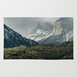 Menacing Mountain peaks with fog coming in Rug