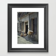 Bicycle on a street by the Zuider Zee in the Netherlands Framed Art Print