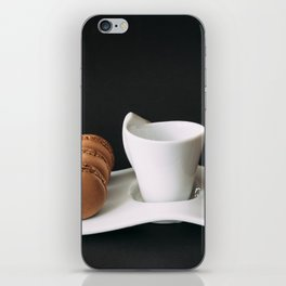 Set of cup of coffee and macaroons against black background iPhone Skin
