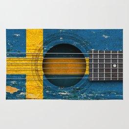 Old Vintage Acoustic Guitar with Swedish Flag Rug